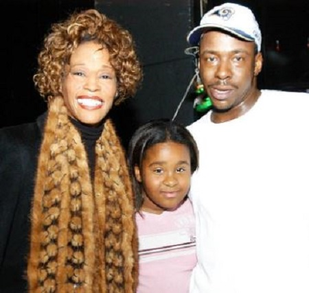 Bobby Brown with his ex wife and daughter, Bobbi Kristina.