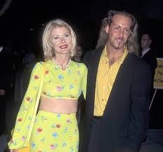 Beth and first husband, Brian Porizek attending an event together