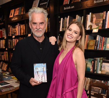 Trevor Eve with his daughter, Alice Eve showing Trevor's book