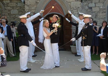 Andrea Canning and Tony Bancroft at their wedding inside the military saber arch