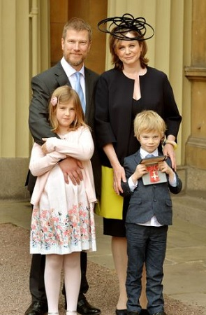 Emily with her husband and kids after receiving the OBE medal