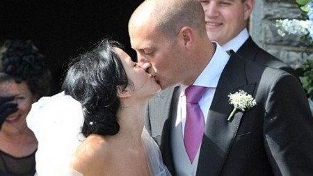 Bret Desmond and Andrea Corr kissing in front of the Church