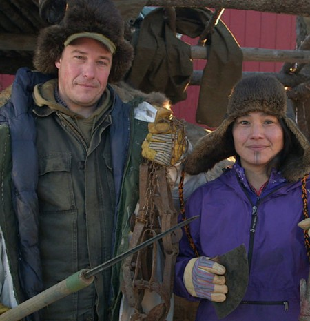 Chip Hailstone with his wife Agnes Hailstone holding a hunting weapon in his hand