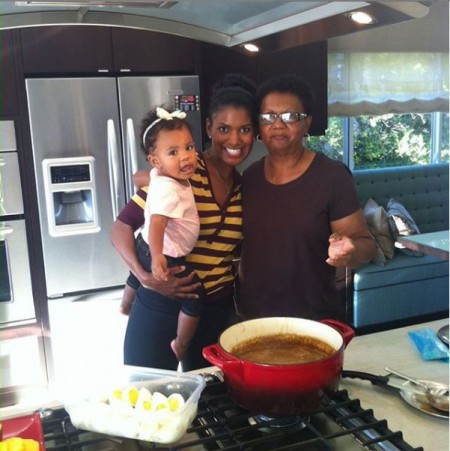 Denise Boutte cooking food for the family with her mother and her daughter