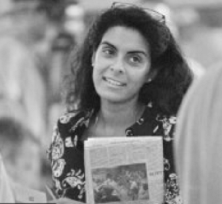 Cal Perry wife, Noreen Jameel captured picture holding a news paper in a hand.