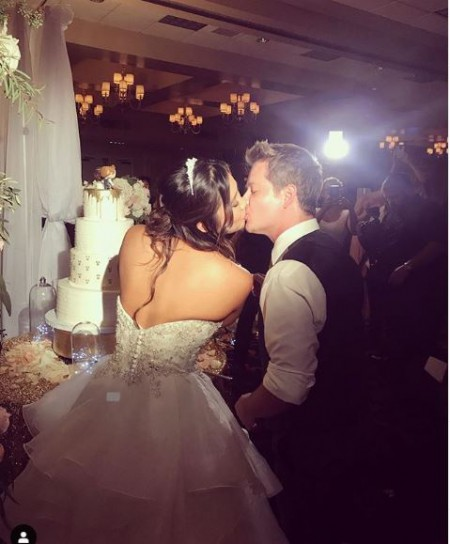 Katie Drysen kissing her husband Jason Earles on the lips at their wedding