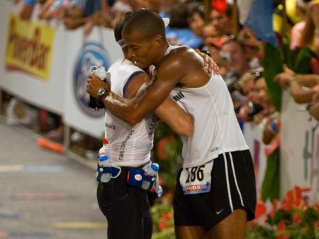 David Goggins hugging a marathon runner
