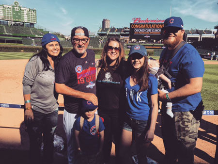Jaye Sousoures and Joe Maddon with their children