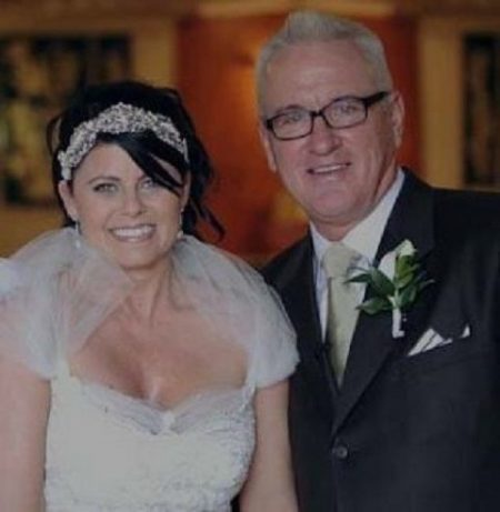 Joe Maddon and Jaye Sousoures posing at their wedding