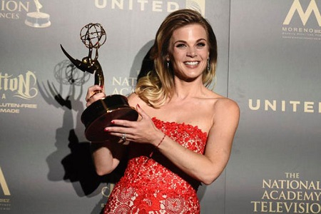 Gina receiving Daytime Emmy Award for her appearance on The Young and The Restless