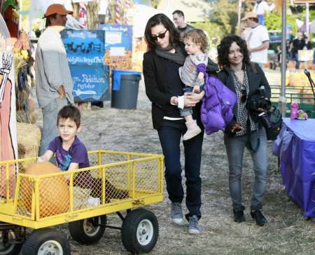 Levi Adler with his parents, Sara Gilbert and Allison Adler carrying Sawyer