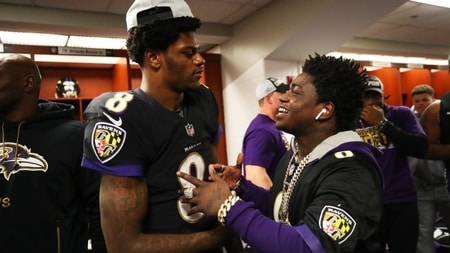 Lamar Jackson celebrating with Kodak Black after Baltimore Ravens win
