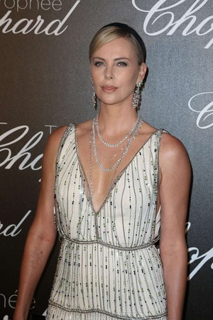 Charlize looking stunning in white deep neckline dress