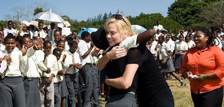 Charlize with her CTAOP team supporing African kids