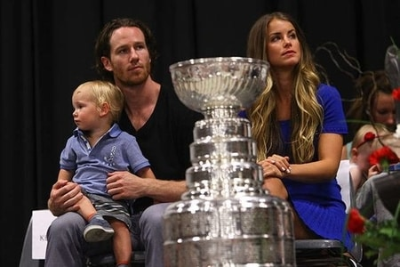 Alexandra Stewart along side Duncan Keith and his son Colton Keith