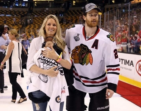 Duncan Keith and Kelly-Rae Keith with their son