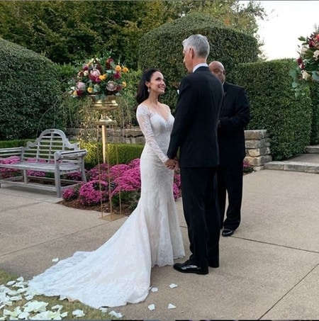 Natalie Solis and Craig Miller exchanging wedding vows with each other at the wedding