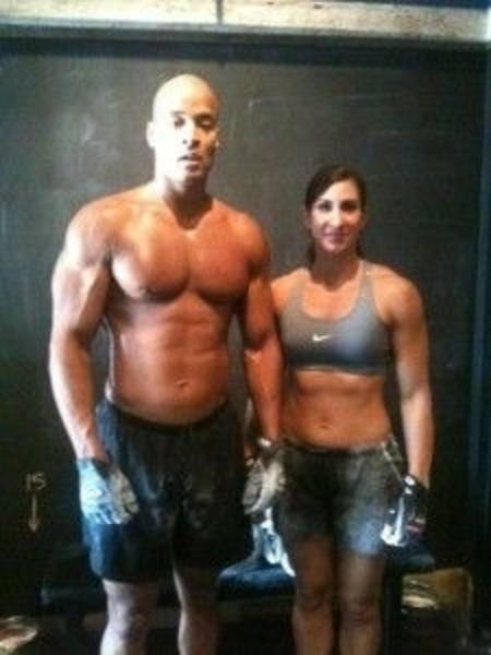David Goggins and his partner Aleeza Goggins at the gym working out