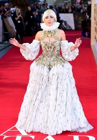 Lady Gaga flaunting her gown which was made by Sarah Burton