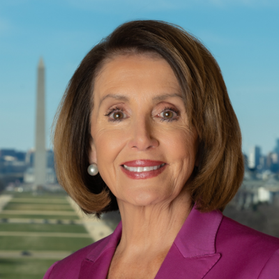 Nancy Pelosi in her purple dress
