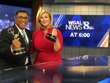 American journalists, Janelle Stelson and Mike Straub holding their Emmy Award