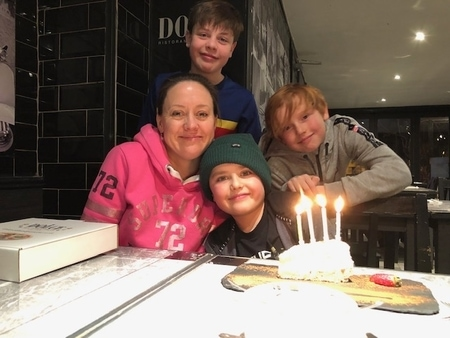Sally Bundock with her three sons celebrating her youngest child birthday