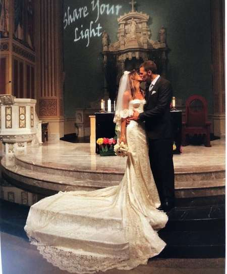 Gisele Bundchen and her spouse, Tom Brady kissing at their wedding ceremony