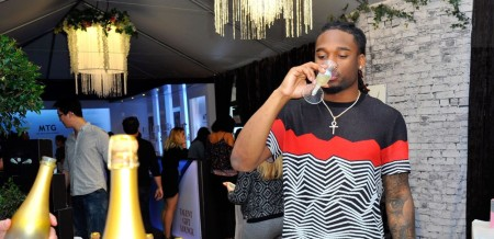 Houston Texans star player, Bradley Roby drinking champagne at the 59th Grammy Awards
