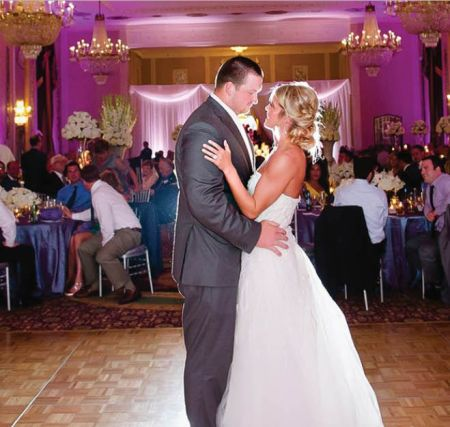 Bryan Bulaga and Abbie Mumpower dancing at their wedding