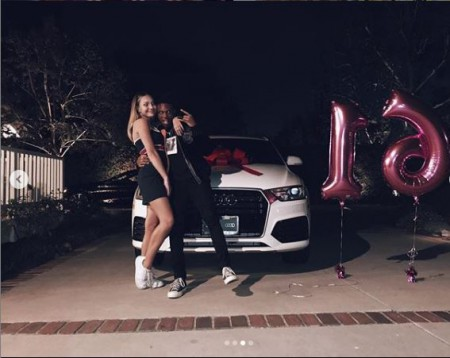 Maddie Ziegler and Kailand Morris posing with Maddie's new car during her sixteenth birthday
