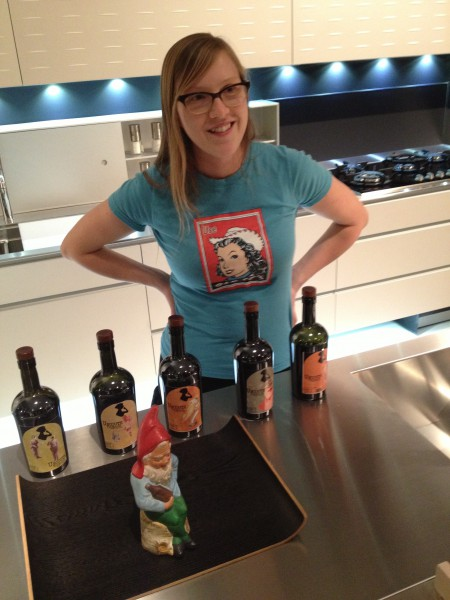 Bianca Beets at her home showcasing her wine bottles
