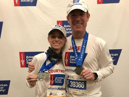 Courtney and her husband runs marathon for cancer cause