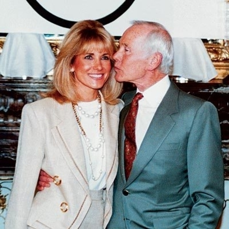 Late Johnny Carson with his wife Alexis Maas at an event