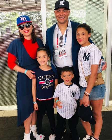 Jessica Beltran with her husband and children