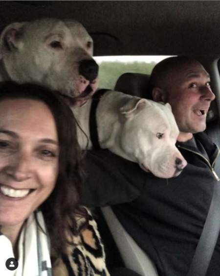 Ian with his wife and two dogs