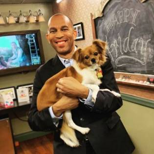 David Gura's pet dog, Ruby on the hands of Hakeem Jeffries