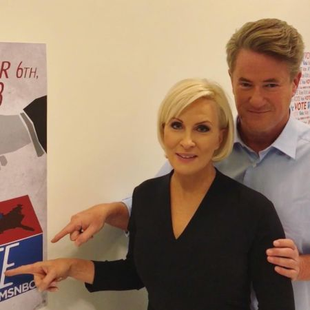 Joe and Mika pointing at the poster