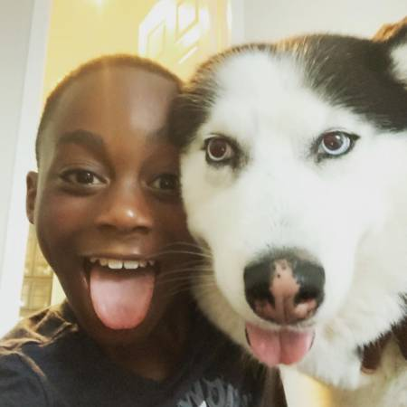 Braylon Howard spends quality time with his pet dog, Blue
