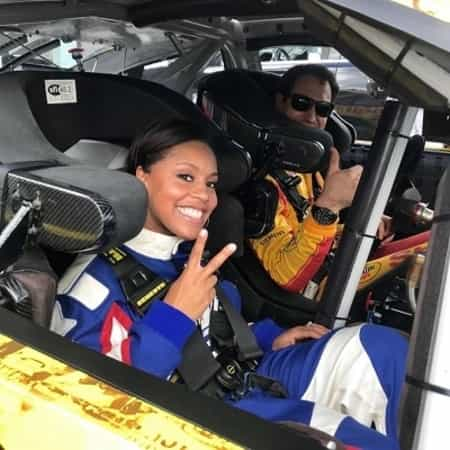 Sheinelle Jones in a car race