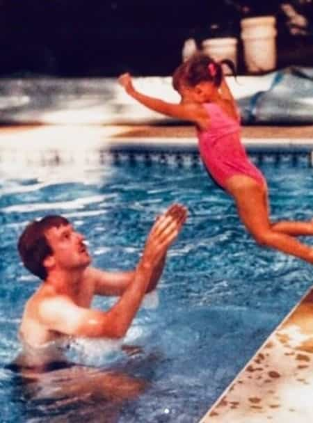 Lisa with her father during her childhood days at the Swimming pool
