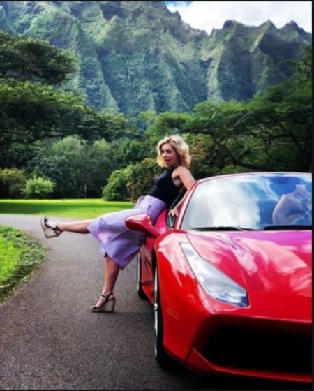 Perdita Weeks posing with Ferrari for the series Magnum P.I.