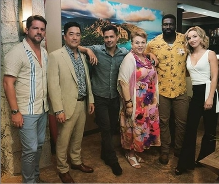 Perdita Weeks with her Magnum P.I. cast