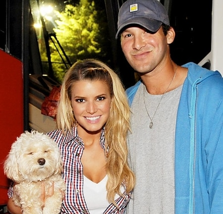Tony Romo with Jessica Simpson and her dog