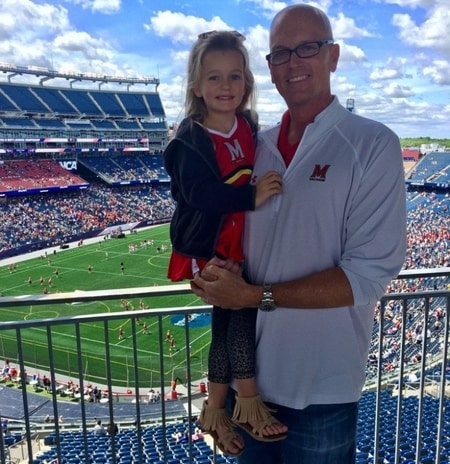 Scott Van Pelt with his daughter Lila Van Pelt at a football match