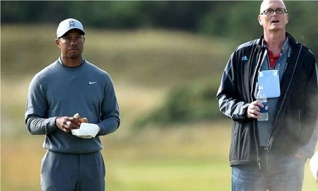 Scott interviewing with Tiger Woods at the golf course