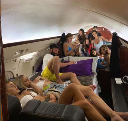 Dan on his private jet surrounded by beauties. Know more about Dan net worth, salary, income, earnings, house, prize money as well as many more as of 2019