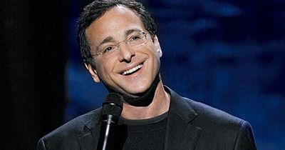 Bob while doing stand-up comedy. Know about Saget's career, profession