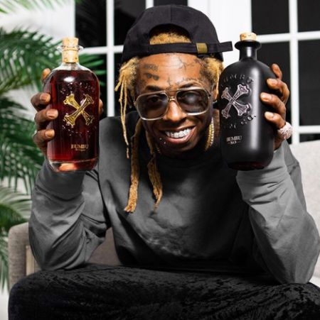 Lil branding harddrink Bumbu. know more about Lil Wayne net worth, salary, bank balance, remuneration, wages, and other sources of income.