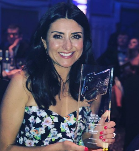 Amy with her award. Know more about her net worth, earnings, income, salary, wages, allowances, total wealth and many more