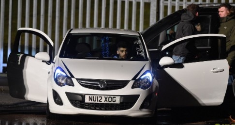 Image: Malik in his car.